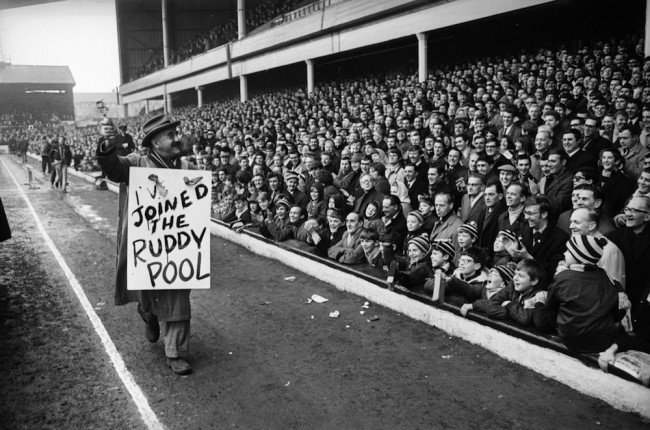 4th February 1968:  Warren Mitchell, star of the television comedy program 'Till Death Us Do Part' at West Ham United's Football Stadium, Upton Park, in the East-End of London.  (Photo by Express/Express/Getty Images)