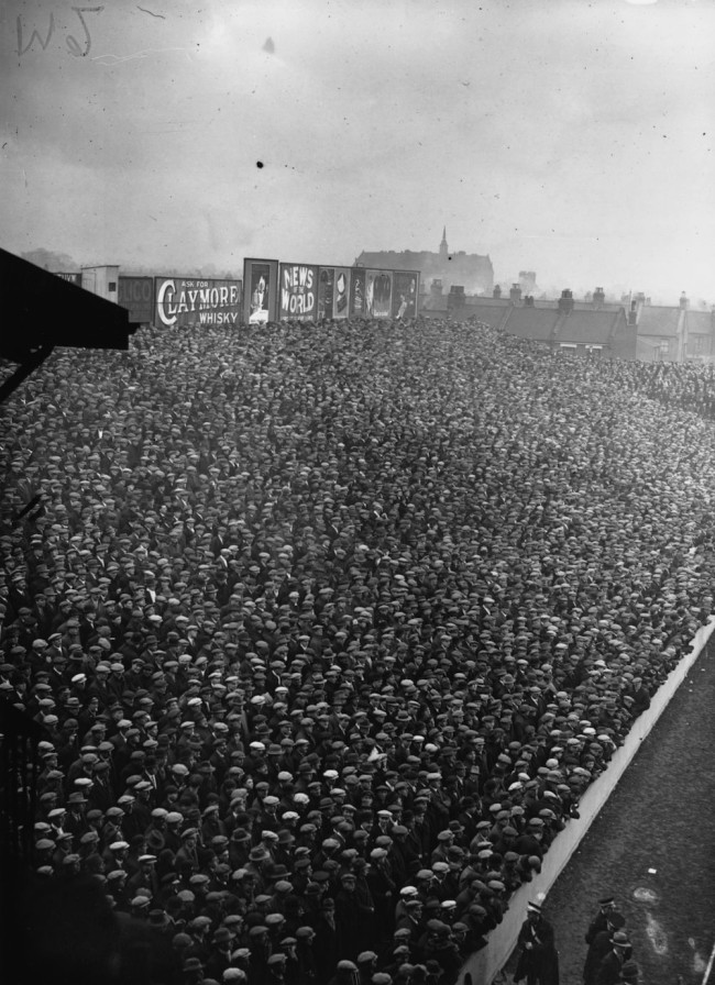 26th January 1929:  Crowds of hat-wearing football fans at a cup tie match between West Ham United and the Corinthians at Upton Park.  (Photo by Edward G. Malindine/Topical Press Agency/Getty Images)