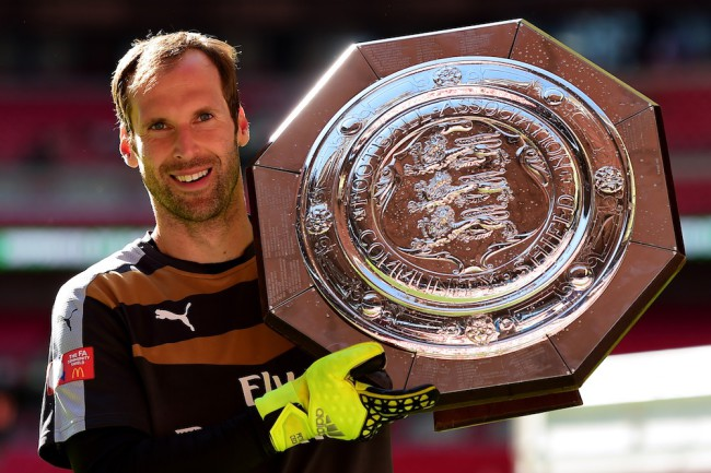 LONDON, ENGLAND - AUGUST 02:  Petr Cech of Arsenal poses for photographs with the trophy after his team's 1-0 win in the FA Community Shield match between Chelsea and Arsenal at Wembley Stadium on August 2, 2015 in London, England.  (Photo by Jamie McDonald/Getty Images)