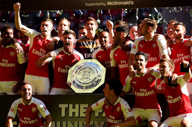 LONDON, ENGLAND - AUGUST 02:  Arsenal players celebrate with the trophy after their team's 1-0 win in the FA Community Shield match between Chelsea and Arsenal at Wembley Stadium on August 2, 2015 in London, England.  (Photo by Jamie McDonald/Getty Images)