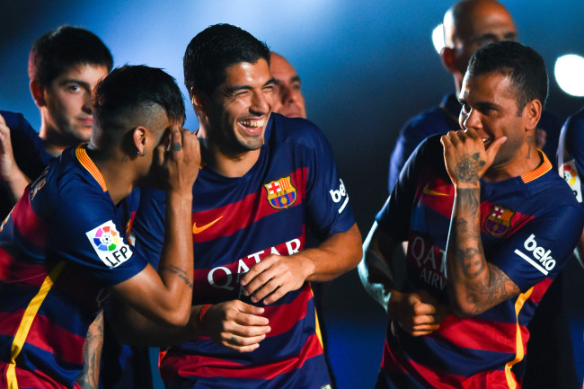 BARCELONA, SPAIN - AUGUST 05:  (L-R) Neymar, Luis Suarez and Dani Alves of FC Barcelona share a joke during the team official presentation ahead of the Joan Gamper trophy match at Camp Nou on August 5, 2015 in Barcelona, Spain.  (Photo by David Ramos/Getty Images)
