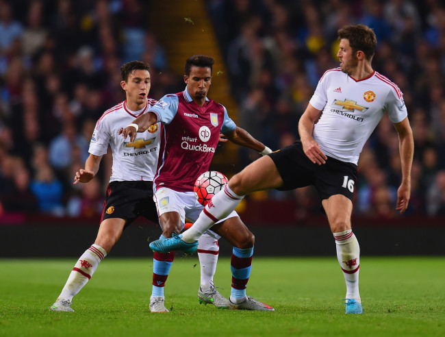 BIRMINGHAM, ENGLAND - AUGUST 14: Scott Sinclair of Aston Villa is closed down by Matteo Darmian and Michael Carrick of Manchester United  during the Barclays Premier League match between Aston Villa and Manchester United on August 14, 2015 in Birmingham, United Kingdom.  (Photo by Michael Regan/Getty Images)
