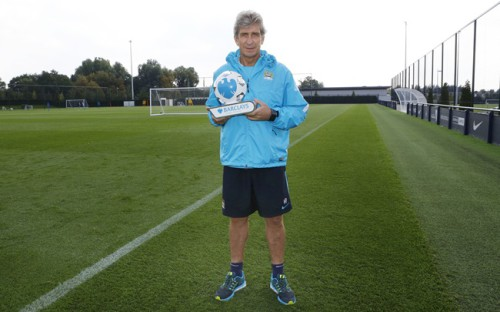Pr Shoot - Barclays PR Shoot 10/09/2015 - Manchester City Training Ground - 10/9/15 Manchester City Manager Manuel Pellegrini poses with the August Manager of the Month Award Mandatory Credit: Action Images / Craig Brough Livepic EDITORIAL USE ONLY.