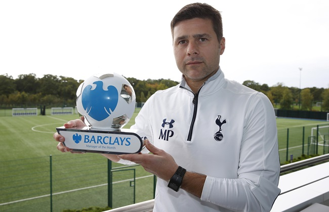 Pr Shoot - Barclays PR Shoot 13/10/2015 - Tottenham Hotspur Training Ground - 13/10/15 Tottenham Hotspur manager Mauricio Pochettino with the Barclays Manager of the month award for September Mandatory Credit: Action Images / Peter Cziborra Livepic