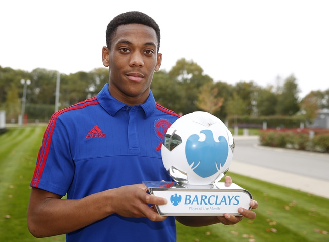 Pr Shoot - Barclays PR Shoot - Manchester United Training Ground - 15/10/15 Manchester United's Anthony Martial receives the Barclays Player of Month Award  Mandatory Credit: Action Images / Lee Smith Livepic