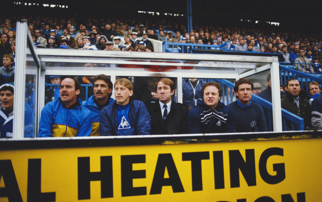 SHEFFIELD, UNITED KINGDOM - MAY 04:  Everton substitute Alan Harper (3rd left) manager Howard Kendall (3rd right) and assistant Colin Harvey (r) look on during a 1-0 Everton victory against Sheffield Wednesday in a League Division one match at Hillsbrough on May 4, 1985 in Sheffield, England.  (Photo by Allsport/Getty Images)