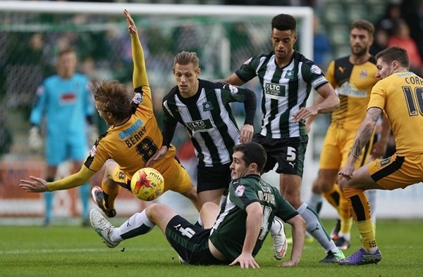 Plymouth's Carl McHugh tackles Cambridge Utd's Luke Berry - Photo mandatory by-line: Dave Rowntree/Pinnacle - Tel: +44(0)1363 881025 - Mobile:0797 1270 681  - VAT Reg No: 183700120 - 12/12/2015 - SPORT - FOOTBALL - Sky Bet League 2, - Plymouth Argyle v Cambridge Utd, Home Park, Plymouth, Devon. Restrictions: EDITORIAL USE ONLY.