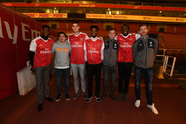 LONDON, ENGLAND - JANUARY 10: Juan Hernangomez #41, Kenneth Faried #35, Emmanual Mudiay #0, Malik Beasley #25 of the Denver Nuggets pose for a photo with Rob Holding, Hector Bellerin and Per Mertesacker of Arsenal Football Club as part of 2017 NBA London Global Games at Emirates Stadium on January 10, 2017 in London, England. NOTE TO USER: User expressly acknowledges and agrees that, by downloading and/or using this Photograph, user is consenting to the terms and conditions of the Getty Images License Agreement. Mandatory Copyright Notice: Copyright 2017 NBAE (Photo by Garrett Ellwood/NBAE via Getty Images)